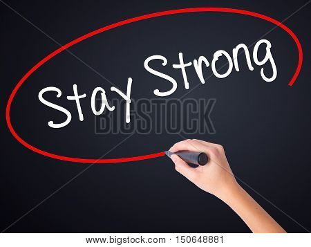 Woman Hand Writing Stay Strong With A Marker Over Transparent Board .