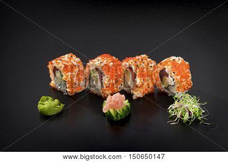 Delicious Sushi set.Uramaki sushi rolls decorated with caviar