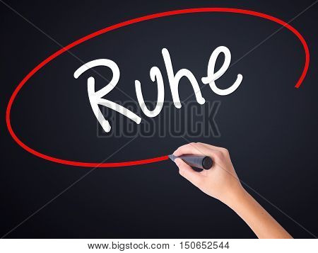 Woman Hand Writing Ruhe (quiet In German) With A Marker Over Transparent Board