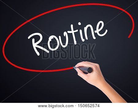 Woman Hand Writing Routine  With A Marker Over Transparent Board