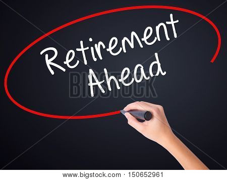 Woman Hand Writing Retirement Ahead With A Marker Over Transparent Board