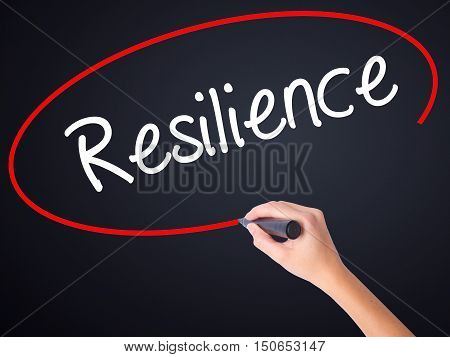 Woman Hand Writing Resilience With A Marker Over Transparent Board
