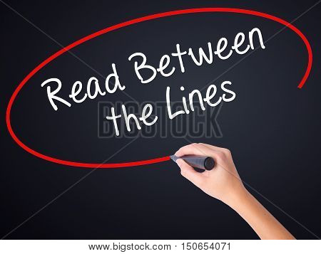 Woman Hand Writing Read Between The Lines   With A Marker Over Transparent Board