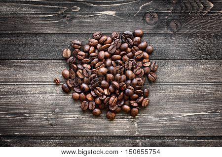 coffee beans on darken wooden old background
