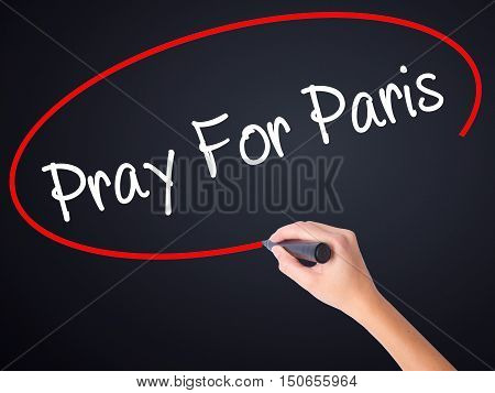 Woman Hand Writing Pray For Paris With Marker On Visual Screen
