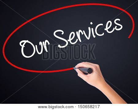 Woman Hand Writing Our Services With A Marker Over Transparent Board