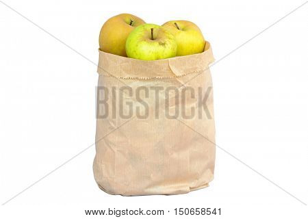 Imperfect looking organic apples with unconventionally raised method, no genetically modified organism techniques, in brown grocery bag.