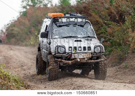 KRASNORECHENSKOYE RUSSIA - SEPTEMBER 24 2016: Small japaneese SUV Suzuki Jimny with off-road tuning on dirt road