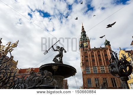 Gdansk Poland - October 04 2016: Neptune statue in the old city Gdansk located near old building of CityHall