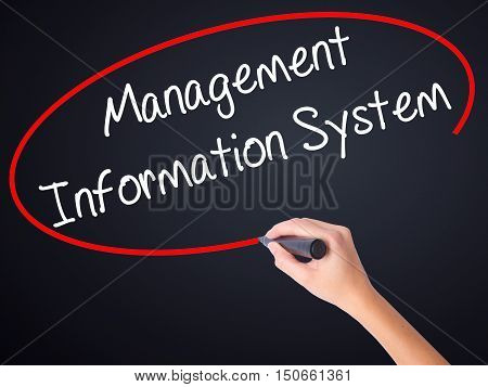 Woman Hand Writing Management Information System With A Marker Over Transparent Board .