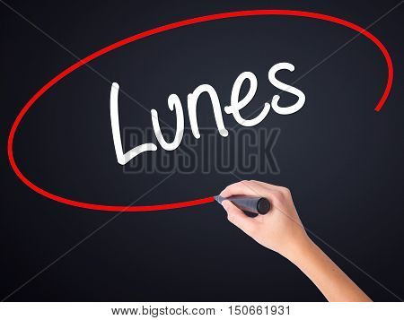 Woman Hand Writing Lunes (monday In Spanish) With A Marker Over Transparent Board