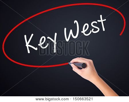 Woman Hand Writing Key West With A Marker Over Transparent Board