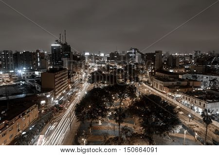 Lima, Peru - September 06, 2015: Black and white shot of Kennedy park in the centre of the district Miraflores at night