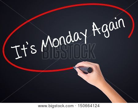 Woman Hand Writing It's Monday Again With A Marker Over Transparent Board
