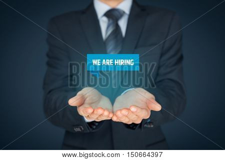 Headhunter (recruiter) hold virtual label with text we are hiring - human resources concept.