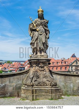 Statue of Saint Cunigunde of Luxembourg as Holy Roman Empress stands over the Regnitz river in Bamberg Bavaria Germany. Built 1750 from Johann Peter Benkert.