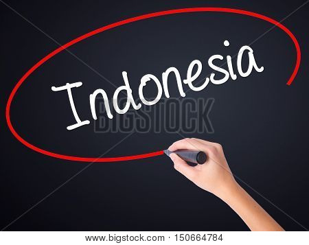 Woman Hand Writing Indonesia  With A Marker Over Transparent Board