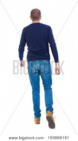 Back view of going  handsome man. walking young guy . Rear view people collection.  backside view of person.  Isolated over white background. Man in warm jacket goes away.