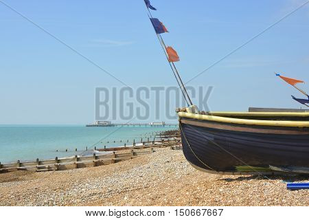 Fishing boats drawn up on the beach at Worthing West Sussex England