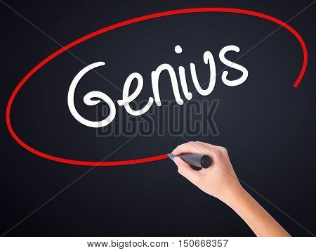Woman Hand Writing Genius  With A Marker Over Transparent Board .