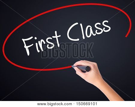 Woman Hand Writing First Class With A Marker Over Transparent Board