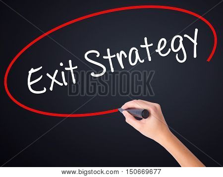 Woman Hand Writing Exit Strategy With A Marker Over Transparent Board .
