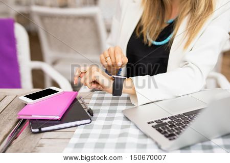 Woman with touch screen watch planning her schedule