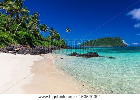 Vibrant tropical Lalomanu beach on Samoa Island with coconut palm trees