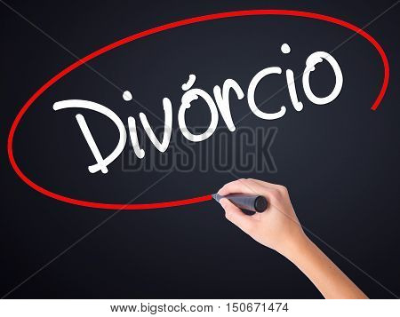 Woman Hand Writing Divorcio (divorce In Portuguese) With A Marker Over Transparent Board .