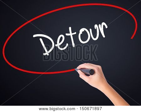 Woman Hand Writing Detour  With A Marker Over Transparent Board
