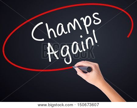 Woman Hand Writing Champs Again With A Marker Over Transparent Board