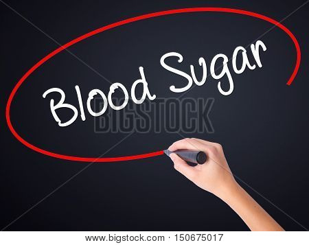 Woman Hand Writing Blood Sugar With A Marker Over Transparent Board