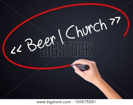 Woman Hand Writing Beer - Church With A Marker Over Transparent Board .