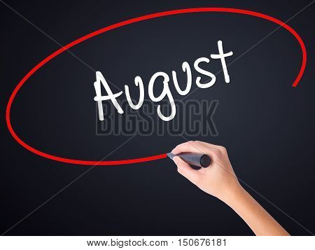 Woman Hand Writing August  With A Marker Over Transparent Board