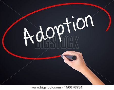 Woman Hand Writing Adoption With A Marker Over Transparent Board