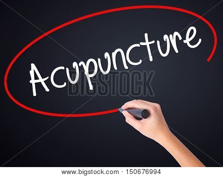 Woman Hand Writing Acupuncture With A Marker Over Transparent Board .