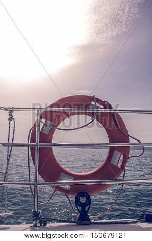 HDR tone effect of Life preserver on luxury sailing yacht