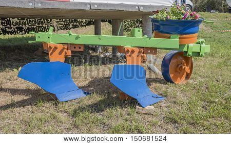 Plough for processing agricultural fields . 2016