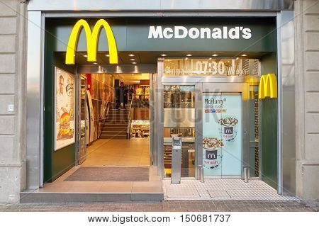 BARCELONA, SPAIN - 20 NOVEMBER, 2015: McDonald's in Barcelona. McDonald's is the world's largest chain of hamburger fast food restaurants