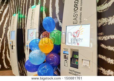 BARCELONA, SPAIN - 20 NOVEMBER, 2015: self-service kiosks at McDonald's restaurant. McDonald's is the world's largest chain of hamburger fast food restaurants
