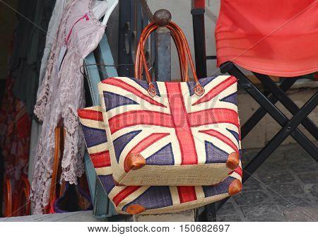 Union Jack flag on handbag and summer dress on outside market