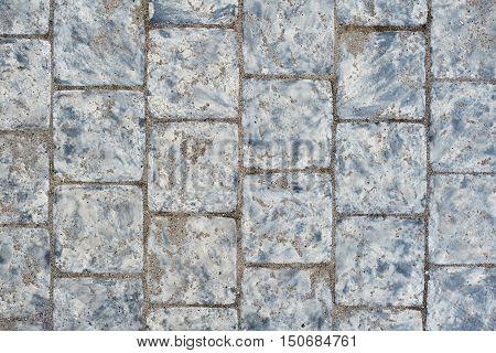 Background of sett. Cobblestone pavement. Texture. Close up