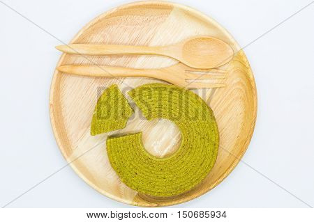 Top view, Green tea cake on wooden board, on white background