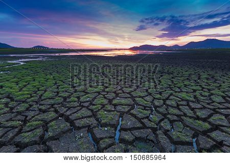 Natural cracked land with beautiful sunset sky background, natural landscape background
