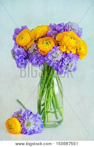 Beautiful bouquet of flowers.Yellow ranunculus flowers close-up in a glass vase .