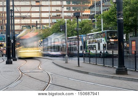 Manchester England - September 23 2016: Piccadilly central bus and metro station with moving tram and buses in Piccadilly gardens at the city of Manchester in England