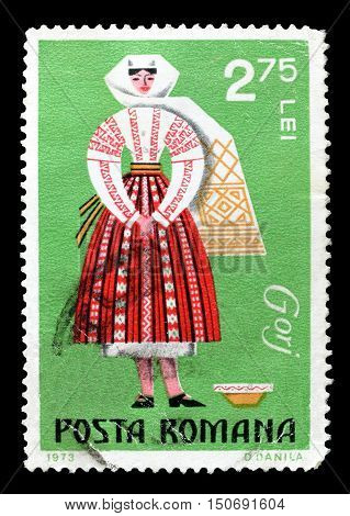 ROMANIA - CIRCA 1973 : Cancelled postage stamp printed by Romania, that shows Regional costume.