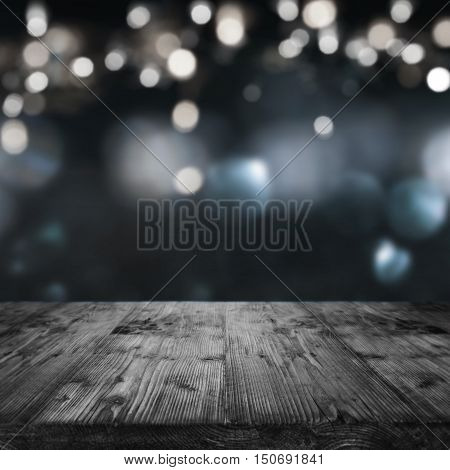 Background for festive occasions with lights in front of a wooden table