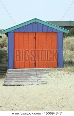 Red and blue beach hut in Melbourne, Australia