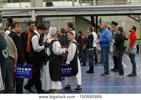 Manheim PA - October 1 2016: Amish women hold Donald Trump campaign signs at a political rally.